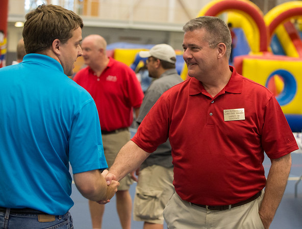 Illinois State Treasurer and Candidate for Governor Dan Rutherford greets contributors during the 19th Annual Porky Picnic at The Vaughan Athletic Center in Aurora, IL on Saturday, August 10, 2013 (Sean King for Shaw Media)