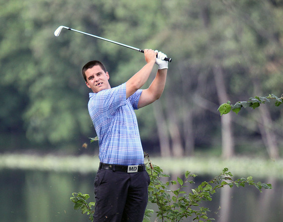 Jeff Krage – For Shaw Media<br /> Matt Daly watches his fourth tee shot during Sunday's championship flight of the St. Charles Men's Golf Tournament at Pottawatomie Golf Course. <br /> St. Charles 8/11/13