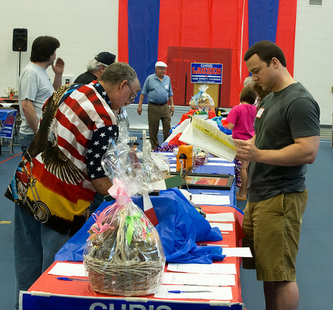 Contributors participate in a silent auction at the 19th Annual Porky Picnic at The Vaughan Athletic Center in Aurora, IL on Saturday, August 10, 2013 (Sean King for Shaw Media)