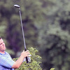 Jeff Krage – For Shaw Media<br /> Matt Daly watches his fifth tee shot during Sunday's championship flight of the St. Charles Men's Golf Tournament at Pottawatomie Golf Course. <br /> St. Charles 8/11/13
