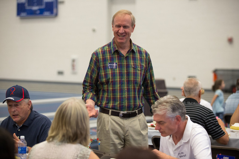 Candidate for the governor of Illinois Bruce Rauner speaks with contributors during the 19th Annual Porky Picnic<br /> at The Vaughan Athletic Center in Aurora, IL on Saturday, August 10, 2013 (Sean King for Shaw Media)