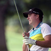 Jeff Krage – For Shaw Media<br /> Chris Thomas reacts after hitting a shot from under the tree on the 5th hole during Sunday's championship flight of the St. Charles Men's Golf Tournament at Pottawatomie Golf Course. <br /> St. Charles 8/11/13