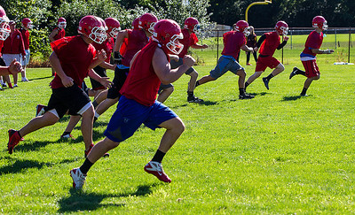 Kyle Grillot - kgrillot@shawmedia.com   Varsity football players run sprints during the first day of practice at Marian Central High School Wednesday, August 14, 2013.
