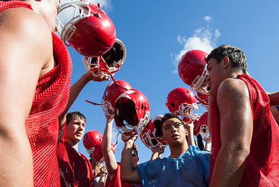 Kyle Grillot - kgrillot@shawmedia.com   The Marian Cenral Varsity team says a prayer to conclude their first practice of day at Marian Central High School Wednesday, August 14, 2013.