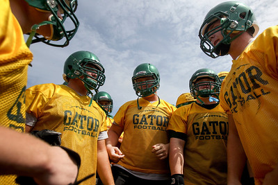 Sarah Nader -  snader@shawmedia.com Crystal Lake South's football team huddles during Thursday's practice in Crystal Lake August 15, 2013.