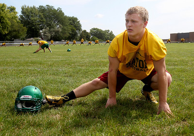 Sarah Nader -  snader@shawmedia.com Crystal Lake South's Chris Ivers stretches during Thursday's football practice at Crystal Lake High School August 15, 2013.