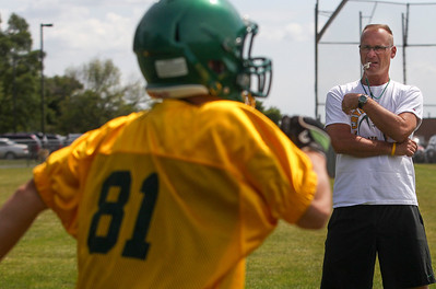 Sarah Nader -  snader@shawmedia.com Crystal Lake South football coach Chuck Ahsmann watches football drills during Thursday's football practice at Crystal Lake High School August 15, 2013.