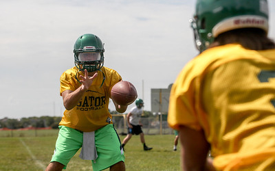 Sarah Nader -  snader@shawmedia.com Crystal Lake South's Austin Rogers catches a pass during Thursday's football practice at Crystal Lake High School August 15, 2013.
