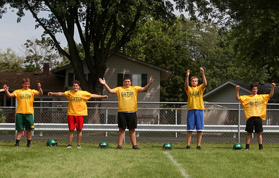 Sarah Nader -  snader@shawmedia.com Crystal Lake South football players warm up during Thursday's football practice at Crystal Lake High School August 15, 2013.