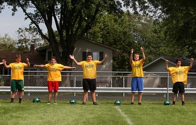 Sarah Nader -  snader@shawmedia.com Crystal Lake South football players warm up during Thursday's football practice at Crystal Lake High School August 15, 2013.