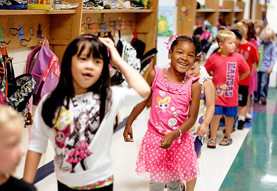 Sarah Nader -  snader@shawmedia.com Janayla McDowell (center), 5, of Woodstock walks down the hall with her classmates during the first day of  kindergarden at Verda Dierzen Early Learning Center in Woodstock Thursday, August 15, 2013.