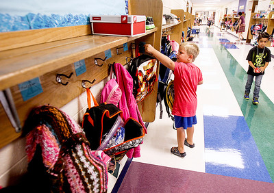 Sarah Nader -  snader@shawmedia.com Trevor Nelson, 5, of Woodstock hangs up his backpack  during the first day of  kindergarden at Verda Dierzen Early Learning Center in Woodstock Thursday, August 15, 2013.