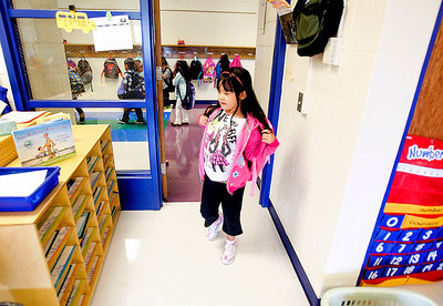 Sarah Nader -  snader@shawmedia.com Isabelle Alberto, 5, of Woodstock walks into her kindergarden classroom during the first day of class at Verda Dierzen Early Learning Center in Woodstock Thursday, August 15, 2013.