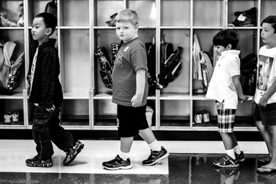 Sarah Nader -  snader@shawmedia.com Ryan Stallman (center), 5, of Woodstock walk down the hallway with his classmates during the first day of  kindergarden at Verda Dierzen Early Learning Center in Woodstock Thursday, August 15, 2013.