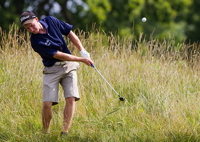 Kyle Grillot - kgrillot@shawmedia.com   Cary-Grove senior Peter Kalamaras chips his ball at the Golf Club of Illinois in Algonquin during the Crystal Lake South golf meet Monday, August 19, 2013.