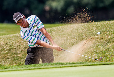 Kyle Grillot - kgrillot@shawmedia.com   Crystal Lake South Senior Sean O'Neil chips his ball out of a bunker at the Golf Club of Illinois in Algonquin during the Crystal Lake South golf meet Monday, August 19, 2013.