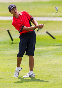 Kyle Grillot - kgrillot@shawmedia.com   Crystal Lake Central junior Luke Garoufalas watches after hitting his ball at the Golf Club of Illinois in Algonquin during the Crystal Lake South golf meet Monday, August 19, 2013.