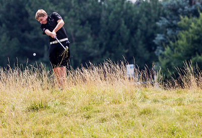 Kyle Grillot - kgrillot@shawmedia.com   Prairie Ridge senior Sean Spangard chips his ball out of the grass at the Golf Club of Illinois in Algonquin during the Crystal Lake South golf meet Monday, August 19, 2013.
