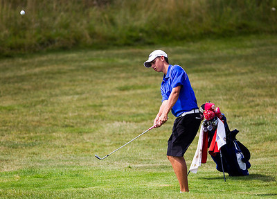 Kyle Grillot - kgrillot@shawmedia.com   Burlington Central Senior Matt Weber chips his ball at the Golf Club of Illinois in Algonquin during the Crystal Lake South golf meet Monday, August 19, 2013.