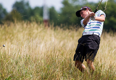 Kyle Grillot - kgrillot@shawmedia.com   Crystal Lake South Senior Sean O'Neil chips his ball out of the grass at the Golf Club of Illinois in Algonquin during the Crystal Lake South golf meet Monday, August 19, 2013.