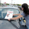 "Stephanie McNeil on Saturday placed ""missing"" fliers on cars in a Wheaton parking lot. Her brother, St. Charles resident John Spira, was last seen Feb. 23, 2007, at Universal Cable Construction near West Chicago."