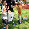 Elburn resident James Hall prepares to try to dunk a Kaneland High School cheerleader Saturday afternoon at Elburn Days at Lions Park, Elburn.
