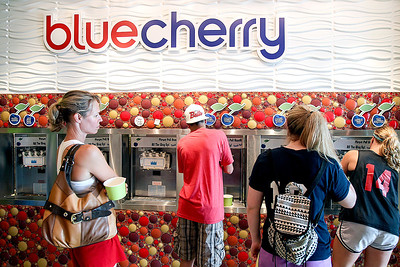 Sarah Nader -  snader@shawmedia.com Students fill up their cups with frozen yogurt at Blue Cherry Frozen Yogurt in Barrington Tuesday, August 20, 2013. Blue Cherry Frozen Yogurt gave away free yogurt to the first 100 people in celebration of the first day of school.