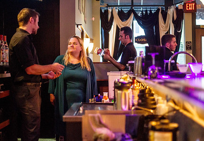 Sarah Nader -  snader@shawmedia.com New owner of Olive Black Martini and Wine Lounge Wendy Espitia (right) talks with bar manager Jeff Popp while working at her Richmond bar Wednesday, August 21, 2013.