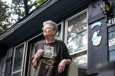 Sarah Nader -  snader@shawmedia.com Donna Mitchell of McHenry poses for a portrait while holding a picture of her twin brother, Corporal Donald MacLean while at her home Thursday, August 22, 2013. Mitchelle was relentless with the U.S military to identify the remains of her brother who has been MIA since the Korean War. MacLean's remains have been identified after being buried in Hawaii with others that were turned over to the U.S. by China.