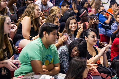 Kyle Grillot - kgrillot@shawmedia.com   Student cheer on Jay Cramer's wife Katy Sullivan while she speaks about her struggles with acting and athleticism at Dundee-Crown High School Friday, August 23, 2013.  Sullivan came back with her husband to speak to thousands of students about overcoming personal challenges.