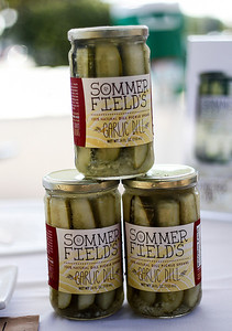 Sarah Nader -  snader@shawmedia.com A collection of Summer Field's garlic dill pickles are displayed during the Crystal Lake farmers market at Depot Park Saturday, August 24, 2013.