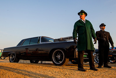 Kyle Grillot - kgrillot@shawmedia.com   Kevin Skoglund of Kewanee dressed as the Green Hornet and Danny Lim of Galesburg dressed as Kato stand next to the Black Beauty car, one of many used in the making of the 2011 film, which was restored and modeled after the Green Hornet's original car during Super Hero Night at the McHenry Outdoor Theater Saturday, August 24, 2013. More than a dozen superheroes from the Costumers with a Cause gather to raise money for the drive-in theater.