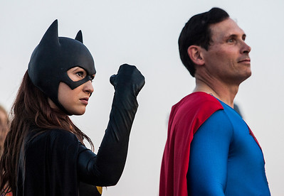 Kyle Grillot - kgrillot@shawmedia.com   Amanda Hamil of Des Plaines poses for fans next to Scott Whipple of Aurora during Super Hero Night at the McHenry Outdoor Theater Saturday, August 24, 2013. More than a dozen superheroes from the Costumers with a Cause gather to raise money for the drive-in theater.