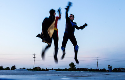 Kyle Grillot - kgrillot@shawmedia.com   Jonathan Onopa dressed as Robbin and Dante Drake dressed as the Nightling both of Chicago high five on top of a building during Super Hero Night at the McHenry Outdoor Theater Saturday, August 24, 2013. More than a dozen superheroes from the Costumers with a Cause gather to raise money for the drive-in theater.