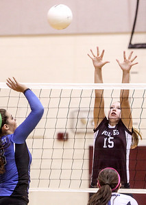 Sarah Nader -  snader@shawmedia.com Prairie Ridge's Kaitlyn Turskey jumps to block a ball during  Tuesday's game against Lake Zurich in Crystal Lake August 27, 2013. Prairie Ridge was defeated  0-2.