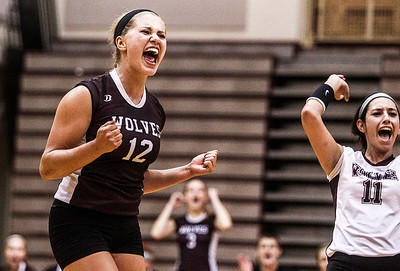 Sarah Nader -  snader@shawmedia.com Prairie Ridge's Charli Beam (left) celebrates a point during  Tuesday's game against Lake Zurich in Crystal Lake August 27, 2013. Prairie Ridge was defeated  0-2.