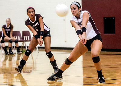 Sarah Nader -  snader@shawmedia.com Prairie Ridge's Olivia Hanley returns a serve during  Tuesday's game against Lake Zurich in Crystal Lake August 27, 2013. Prairie Ridge was defeated  0-2.