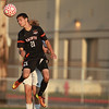 St. Charles East's Daniel DiLeonardi goes up for a header during their game at Batavia Thursday.