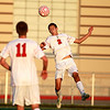 Chase Correll (2) of Batavia heads the ball during their home game against St. Charles East Thursday.