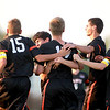 Evan DiLeonardi (center) is congratulated by his St. Charles East teammates after scoring a goal at Batavia Thursday.