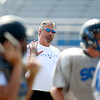 St. Charles North assistant defensive coordinator Rick Magsamen leads his players during practice Thursday. Magsamen is a former assistant coach at Elk Grove High School, where Head Coach Rob Pomazak also coached.