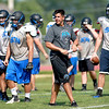 St. Charles North Head Coach Rob Pomazak leads his team during practice Thursday. St. Charles North takes on Pomazak's former team, Elk Grove, tonight.