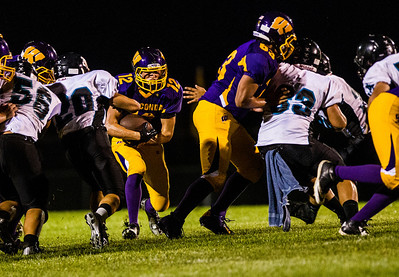 Kyle Grillot - kgrillot@shawmedia.com   Wauconda junior Alex Payne (12) runs through the Woodstock North defense during the second quarter of the high school football game at Wauconda High School Friday, August 30, 2013.