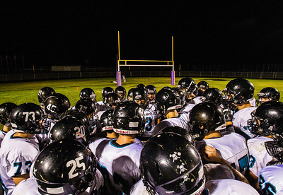 Kyle Grillot - kgrillot@shawmedia.com   The Woodstock North team huddles together during half time of the high school football game at Wauconda High School Friday, August 30, 2013.