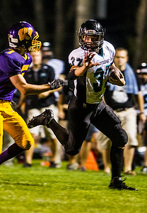 Kyle Grillot - kgrillot@shawmedia.com   Woodstock North junior Jeremy Haymond runs the ball against the defense of Wauconda  during the second quarter of the high school football game at Wauconda High School Friday, August 30, 2013.