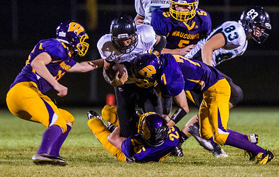 Kyle Grillot - kgrillot@shawmedia.com   Woodstock North senior Grant Wade (center) runs the ball against the Wauconda Defense during the second quarter of the high school football game at Wauconda High School Friday, August 30, 2013.