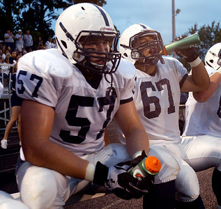 H. Rick Bamman - hbamman@shawmedia.com  Cary-Grove's Trevor Ruhland (57) and  Michael Gomez  rest on the bench during the season opener against Wheaton North Saturday, Aug. 31, 2013.