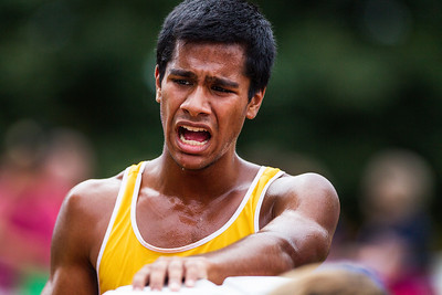 Kyle Grillot - kgrillot@shawmedia.com   Jacobs senior Thomas Chirayil tries to catch his breath after the 3-mile race of the McHenry County Cross Country meet at the McHenry Township Park Saturday, August 31, 2013.