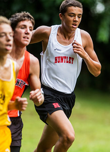 Kyle Grillot - kgrillot@shawmedia.com   Huntley sophomore Keagan Smith (right) runs the 3-mile race during the McHenry County Cross Country meet at the McHenry Township Park Saturday, August 31, 2013. Smith came in fourth place with a time of 16:24.8.