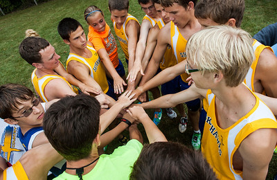 Kyle Grillot - kgrillot@shawmedia.com   The Johnsburg team comes together before the boy's race during the McHenry County Cross Country meet at the McHenry Township Park Saturday, August 31, 2013.